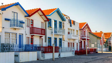 Street with colorful houses in Costa Nova, Aveiro, Portugal. Street with striped houses, Costa Nova, Aveiro, Portugal. Facades of colorful houses in Costa Nova, Aveiro, Portugal. Stock fotó