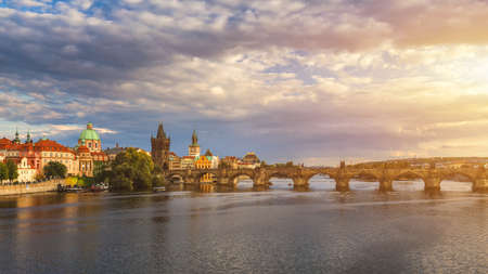 Prague, Czech Republic panorama with historic Charles Bridge and Vltava river on sunny day.