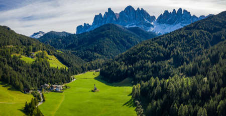 Landscapes with San Giovanni Church and small village in Val di Funes, Dolomite Alps, South Tyrol, Italy, Europe. San Giovanni in Ranui church (St John in Ranui church) in the Dolomites, Italy.