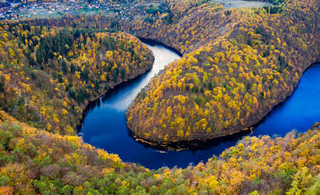 Beautiful Vyhlidka Maj, Lookout Maj, near Teletin, Czech Republic. Meander of the river Vltava surrounded by colorful autumn forest viewed from above. Tourist attraction in Czech landscape. Czechia. Banco de Imagens