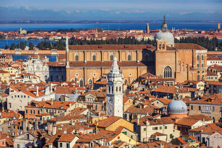Venice panoramic aerial view with red roofs, Veneto, Italy. Aerial view with dense medieval red roofs of Venice, Italy