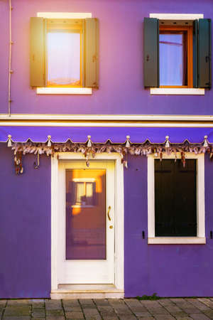 Colorful window of a house on the Venetian island of Burano, Venice. Facade of the houses of Burano close-up. Venice, Italy. Stockfoto - 145648786
