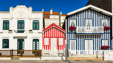 Street with colorful houses in Costa Nova, Aveiro, Portugal. Street with striped houses, Costa Nova, Aveiro, Portugal. Facades of colorful houses in Costa Nova, Aveiro, Portugal. Archivio Fotografico