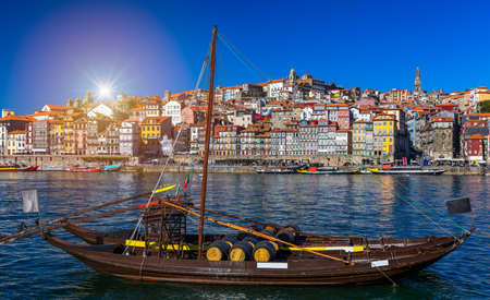 Port wine boats at the waterfront with the old town on the Douro River in Ribeira in the city centre of Porto in Porugal, Europe. Portugal, Porto Banco de Imagens