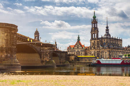 Augustus Bridge (Augustusbrucke) and Cathedral of the Holy Trinity (Hofkirche) over the River Elbe in Dresden, Germany, Saxony. 写真素材