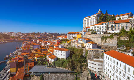 Panoramic view of Old city of Porto (Oporto) and Ribeira over Douro river, Portugal. Concept of world travel, sightseeing and tourism. Banco de Imagens
