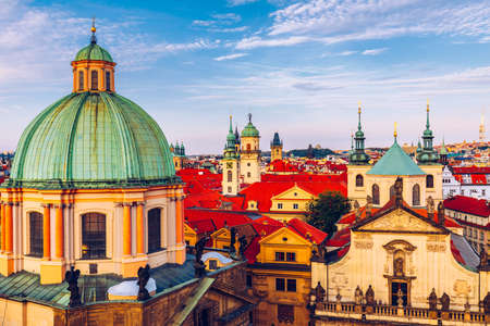 Scenic summer aerial panorama of the Old Town architecture in Prague, Czech Republic. Red roof tiles panorama of Prague old town.  Prague Old Town Square houses with traditional red roofs. Czechia. Banco de Imagens
