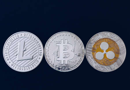 Bitcoin, litecoin and ripple coins currency finance money on graph chart background. Bitcoin as most important cryptocurrency concept. Stack of cryptocurrencies with a golden bitcoin in the middle. 写真素材