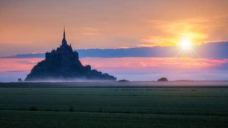 Mont Saint-Michel view in the sunrise light. Normandy, northern France Banco de Imagens
