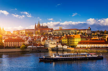Prague Castle, Charles Bridge and boats on the Vltava river. View of Hradcany Prague Castle, Charles Bridge and a boats on the Vltava river in the capital of the Czechia. Boat cruise on Vltava river. Stock fotó - 145650120