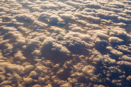 Blanket of clouds. Sun going below a blanket of clouds. On top of a blanket of clouds. Sun going below a blanket of clouds. Smooth view from above with a blanket of clouds. Zdjęcie Seryjne