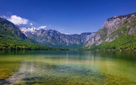 Lake Bohinj in Slovenia, beauty in nature. Colorful summer on the Bohinj lake in Triglav national park Slovenia, Alps, Europe. Mountain Lake bohinj in Julian Alps, Slovenia