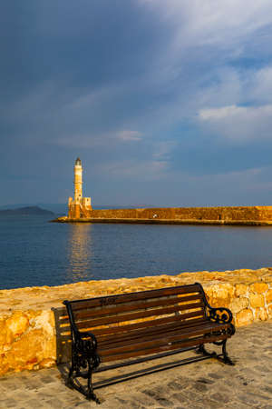 Panorama of venetian harbour waterfront and lighthouse in old harbour of Chania, Crete, Greece. Old venetian lighthouse in Chania, Greece. Lighthouse of the old Venetian port in Chania, Greece. 写真素材 - 145656968