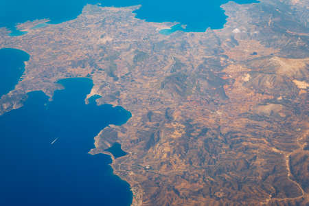 View On Adriatic From Plane. Traveling, Holiday, Vacation Concept. View from airplane on Earth surface. Landscape view of islands from the airplane. Greece Islands From Airplane