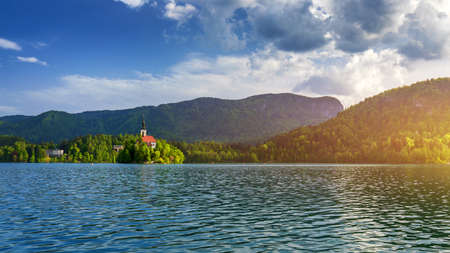 Lake Bled Slovenia. Beautiful mountain Bled lake with small Pilgrimage Church. Most famous Slovenian lake and island Bled with Pilgrimage Church of the Assumption of Maria. Bled, Slovenia.