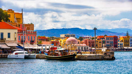 View of old port of Chania. Landmarks of Crete island. Greece. Bay of Chania at sunny summer day, Crete Greece. View of the old port of Chania, Crete, Greece. The port of chania, or Hania. Zdjęcie Seryjne - 145657170