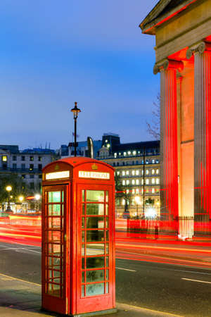 London Telephone box at night with streaming vehicle headlights