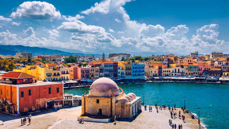 Mosque in the old Venetian harbor of Chania town on Crete island, Greece. Old mosque in Chania. Janissaries or Kioutsouk Hassan Mosque in Chania Crete. Turkish mosque in Chania bay. Crete, Greece. 스톡 콘텐츠 - 145657396