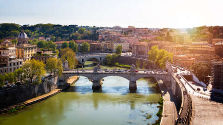 Skyline with bridge Ponte Vittorio Emanuele II and classic architecture in Rome, Vatican City scenery over Tiber river.