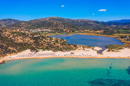 Panorama of the wonderful beaches of Chia, Sardinia, Italy. View of beautiful Chia bay and wonderful beaches, Sardinia island, Italy. Beautiful sea and bay on Su Guideu beach, Sardinia island, Italy