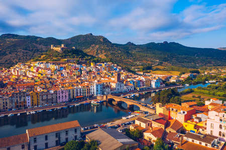 Aerial view of the beautiful village of Bosa with colored houses and a medieval castle. Bosa is located in the north-wesh of Sardinia, Italy. Aerial view of colorful houses in Bosa village, Sardegna. Stock fotó