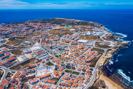 Aerial view of Peniche with the fortress, Peniche peninsula, Portugal. Peniche city buildings at Atlantic ocean coast, Portugal. Фото со стока