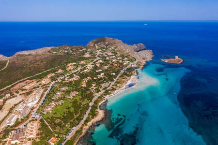 Stunning aerial view of Pelosa Beach (Spiaggia Della Pelosa) with Torre della Pelosa and Capo Falcone. Stintino, Sardinia, Italy. La Pelosa beach, probably the most beautiful beach in Sardinia, Italy Фото со стока