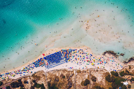 Stunning aerial view of Pelosa Beach (Spiaggia Della Pelosa). Stintino, Sardinia, Italy. La Pelosa beach, Sardinia, Italy. La Pelosa beach, probably the most beautiful beach in Sardinia, Italy 写真素材 - 155850283