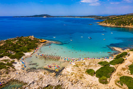 Cost of Sardinia: Peninsula of Punta Molentis. View of beautiful beach at Punta Molentis, Villasimius, Sardinia, Italy. Beautiful bay with sandy beach at Punta Molentis, Sardinia island, Italy. Stockfoto - 155850296