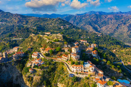 Aerial view of Savoca village in Sicily, Italy. Sicilian village Savoca (known from the Godfather movies). Houses on a hill in Savoca, small town on Sicily in Italy. Stok Fotoğraf - 154888419