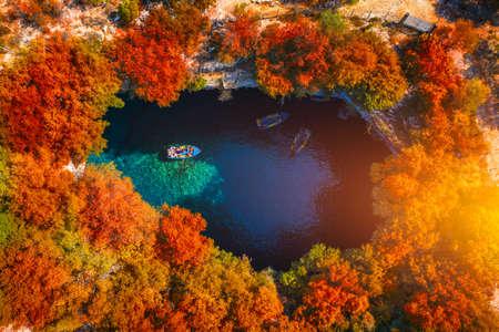 Melissani Cave with autumn colors. Famous Melissani lake on Kefalonia island, Karavomylos, Greece. On top of Melissani Cave (Melissani Lake) in Karavomylos village in Kefalonia island , Greece. Stok Fotoğraf - 154888429