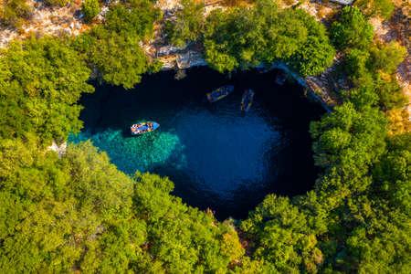 Famous Melissani lake on Kefalonia island, Karavomylos, Greece. On top of Melissani Cave (Melissani Lake) in Karavomylos village in Kefalonia island , Greece. Melissani Cave viewed from above. Standard-Bild