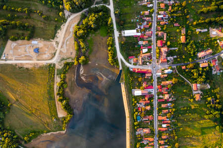 Beautiful Tismana lake and surrounding forest aerial panorama. Tismana, Romania.
