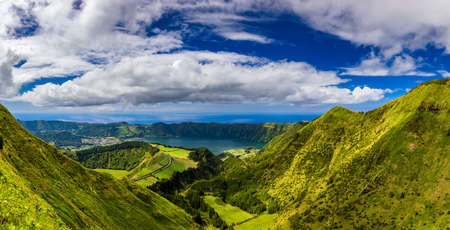 View from Miradouro da Boca do Inferno to Sete Citades, Azores, Portugal. A path leading to viewpoint Miradouro da Boca do Inferno in Sao Miguel Island, Azores, Portugal. Stok Fotoğraf - 154888135