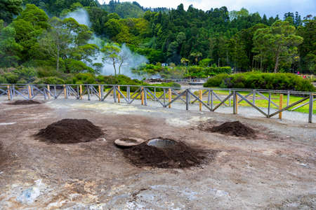 Cooking of Cozido Das Furnas meal, Sao Miguel, Azores. Hole in the ground for cooking Cozido das Furnas, a meat stew cooked by the volcanic steam from Furnas Lake, Sao Miguel, Azores, Portugal. Stok Fotoğraf