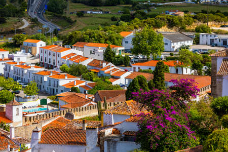 Obidos, Portugal stonewalled city with medieval fortress, historic walled town of Obidos, near Lisbon, Portugal. Beautiful view of Obidos Medieval Town, Portugal. Stockfoto - 156156134