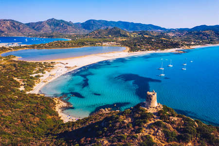 Torre di Porto Giunco Tower and Simius Beach near Villasimius, Sardinia, Italy. View from flying drone. Torre di Porto Giunco tower on Carbonara cape. Aerial morning view of Sardinia island, Italy Stok Fotoğraf