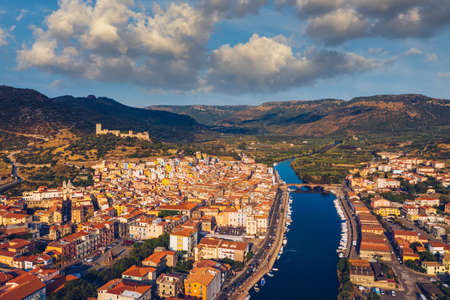 Aerial view of the beautiful village of Bosa with colored houses and a medieval castle. Bosa is located in the north-wesh of Sardinia, Italy. Aerial view of colorful houses in Bosa village, Sardegna. Stok Fotoğraf
