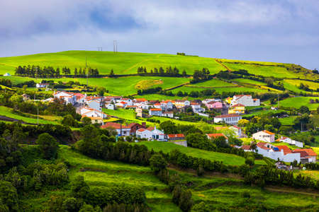 Beautiful nature view on Azores with small villages, tows, green nature fields. Amazing Azores. View of typical Azores village in Sao Miguel island, Azores, Portugal.