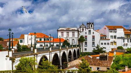 View of Nordeste on Sao Miguel Island, Azores. Old stone arch bridge in Nordeste village, Sao Miguel, Azores. Nordeste village with white town buildings on the island of Sao Miguel, Azores, Portugal.