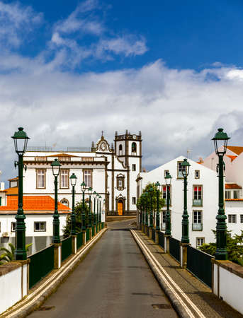 View of Nordeste on Sao Miguel Island, Azores. Old stone arch bridge in Nordeste village, Sao Miguel, Azores. Nordeste village with white town buildings on the island of Sao Miguel, Azores, Portugal.