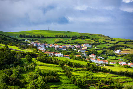 View of Pedreira village at northeast coast of Sao Miguel island, Azores, Portugal. View of Pedreira village and Pico do Bartolomeu at northeast coast of Sao Miguel island, Azores, Portugal.