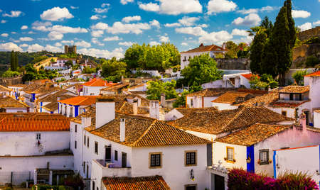 Historic walled town of Obidos, near Lisbon, Portugal. Beautiful streets of Obidos Medieval Town, Portugal. Street view of medieval fortress in Obidos. Portugal. Stockfoto