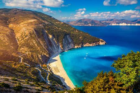 Famous Myrtos beach from overlook, Kefalonia (Cephalonia), Greece. Myrtos beach, Kefalonia island, Greece. Beautiful view of Myrtos beach, Ionian Island, Kefalonia (Cephalonia), Greece.