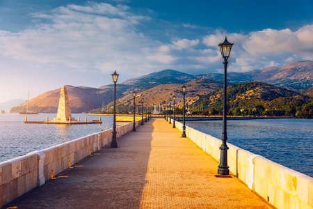 View of the De Bosset Bridge in Argostoli city on Kefalonia island. De Bosset Bridge on lakeside In Argostoli, Kefalonia. Obelisk and the de Bosset bridge in Argostoli, Kefalonia, Greece