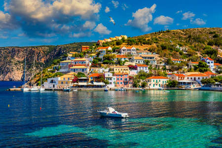 Assos village in Kefalonia, Greece. Turquoise colored bay in Mediterranean sea with beautiful colorful houses in Assos village in Kefalonia, Greece, Ionian island, Cephalonia, Assos village.