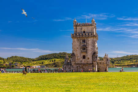 View at the Belem tower at the bank of Tejo River in Lisbon, Portugal. The Belem Tower (Torre de Belem), Lisbon, Portugal. At the margins of the Tejo river, it is an iconic site of the city. Редакционное