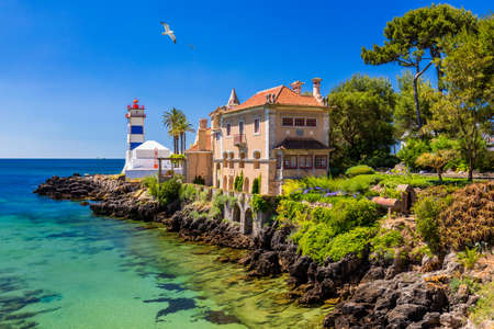 Santa Marta lighthouse and Municipal museum, Cascais, Lisbon, Portugal. Lighthouse Museum of Santa Marta in Cascais Portugal, as seen from Santa Marta Beach on a beautiful day. Cascais, Portugal. Редакционное