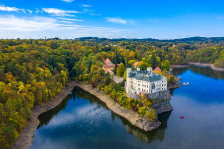 Aerial view chateau Orlik, above Orlik reservoir in beautiful autumn nature. Romantic royal Schwarzenberg castle above water level. Czechia. Orlik castle across the River Vltava, Czech Republic.