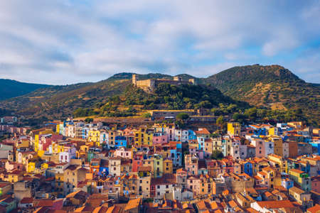 Aerial view of the beautiful village of Bosa with colored houses and a medieval castle. Bosa is located in the north-wesh of Sardinia, Italy. Aerial view of colorful houses in Bosa village, Sardegna. Banco de Imagens - 156134158